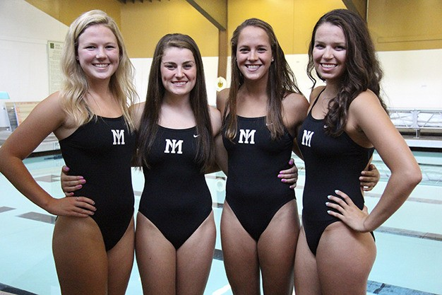 The Mercer Island girls swimming captains this season are Caitlin Cox