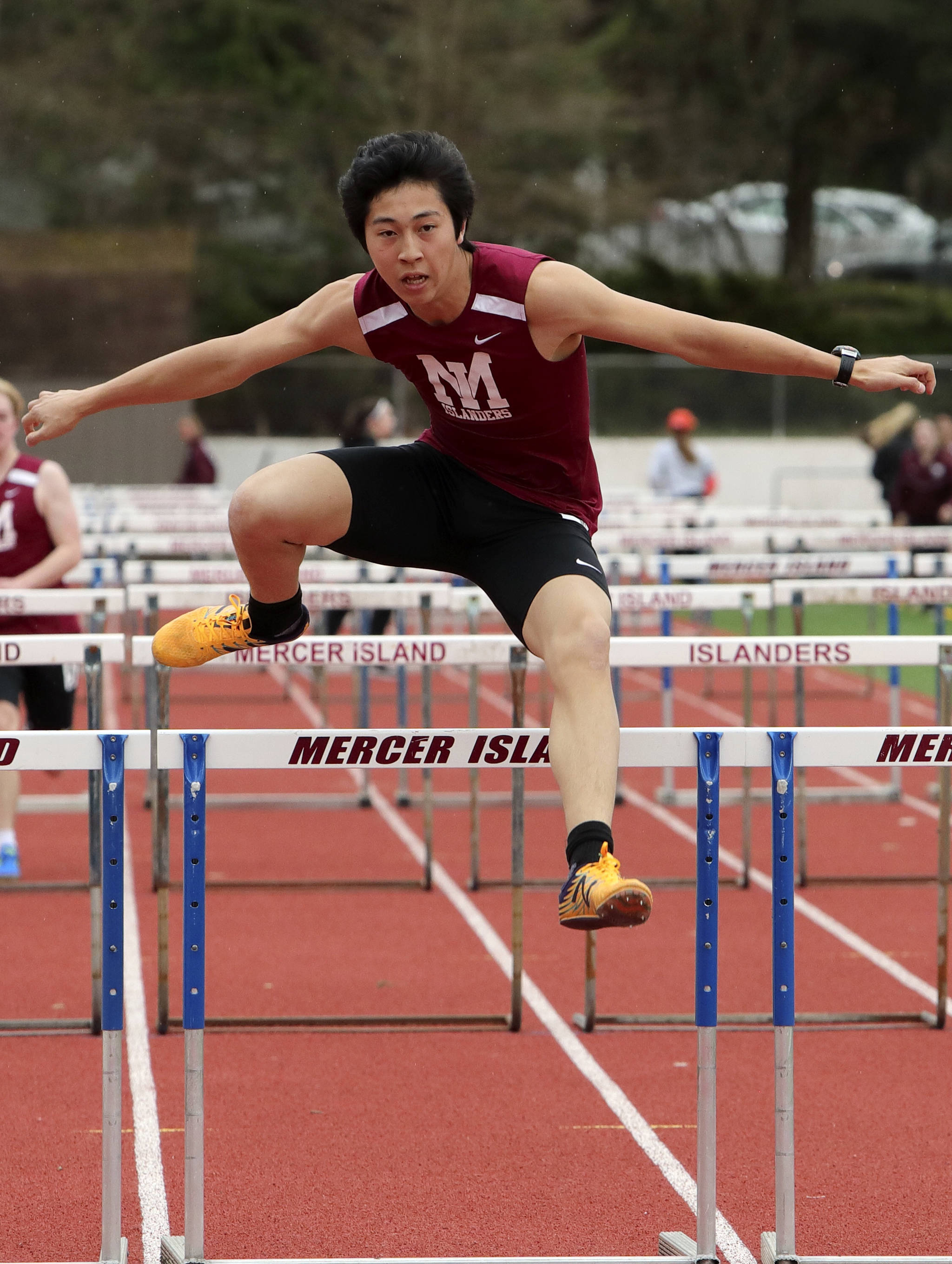 Photo courtesy of Jay Na                                 The Mercer Island Islanders girls track team improved their overall record to 4-0 courtesy of a 89-56 win against Interlake and a 91-58 victory against the Redmond Mustangs in a KingCo 3A/2A double dual on March 29 on Mercer Island.                                 The Mercer Island boys squad lost to Interlake 76-69 and were defeated by Redmond 98-57. Islanders' girls athletes capturing first place in their respective events consisted of Maya Virdell (100 meters, 1600 meter-relay), Gretchen Blohm (200 meters, 800 meter-relay), Kayla Lee (400 meters, 800 meter-relay, 1600 meter-relay), Katie McCormick (100 meter hurdles), Ella Hensey (800 meter-relay, 1600 meter-relay), Eliza Crenshaw (800 meter-relay), Margaret Baker (1600 meter-relay), Faith Osei-Tutu (shot-put, javelin) and Susanna Lepow (pole vault). Islanders' boys athletes earning first place in their events were Colin Farrell (100 meters, 200 meters), Jack Clayville (110 hurdles), Mitchell Kirby (300 hurdles), Eli Yen (discus) and Jeffery Tian (pole vault). Yian (pictured) competes in the 110 hurdles in a double dual against the Interlake Saints and Redmond Mustangs on March 29.