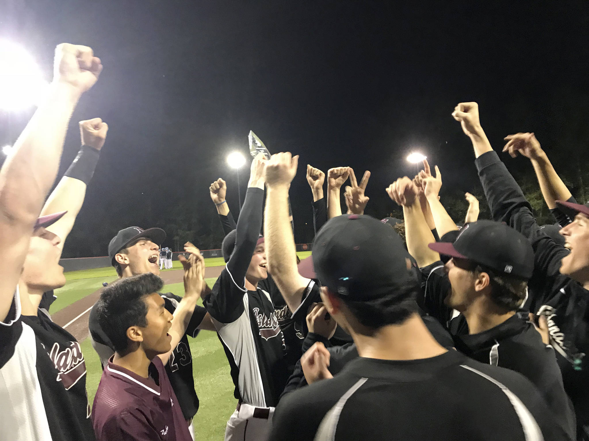 Mercer Island Islanders celebrate after being presented the KingCo 3A baseball tournament championship trophy just minutes following the final out against the Interlake Saints on May 6 at Bannerwood Park in Bellevue. Shaun Scott/staff photo