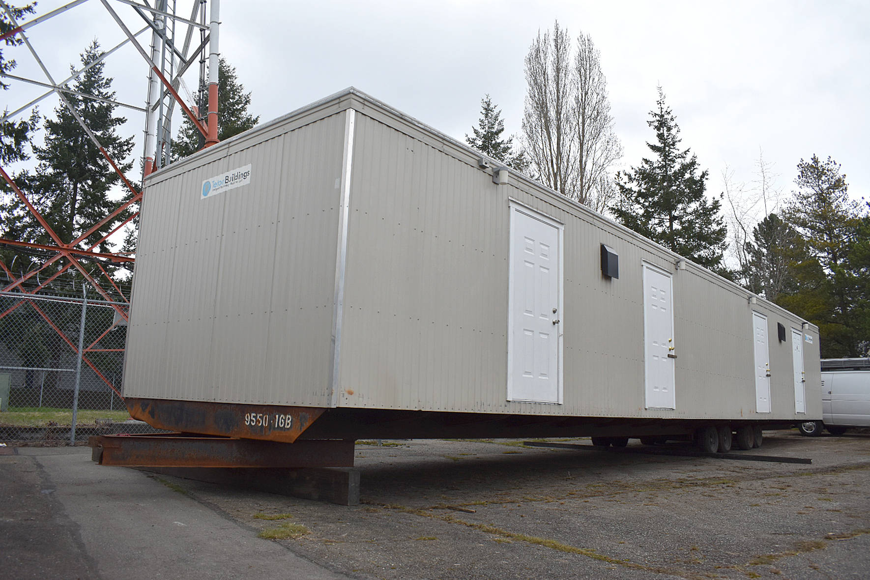 Photo by Haley Ausbun. A preview of the first modular unit being used to house King County residents under quarantine for COVID-19, coronavirus. The units will be located on a county-onward parcel in White Center, where an old office building is planned to be demolished to make space.